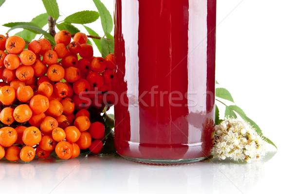 Cropped orange ash-berry with jar of juice on white Stock photo © dla4
