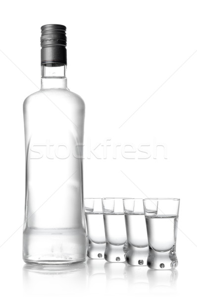 Bottle and glasses of vodka isolated on white Stock photo © dla4