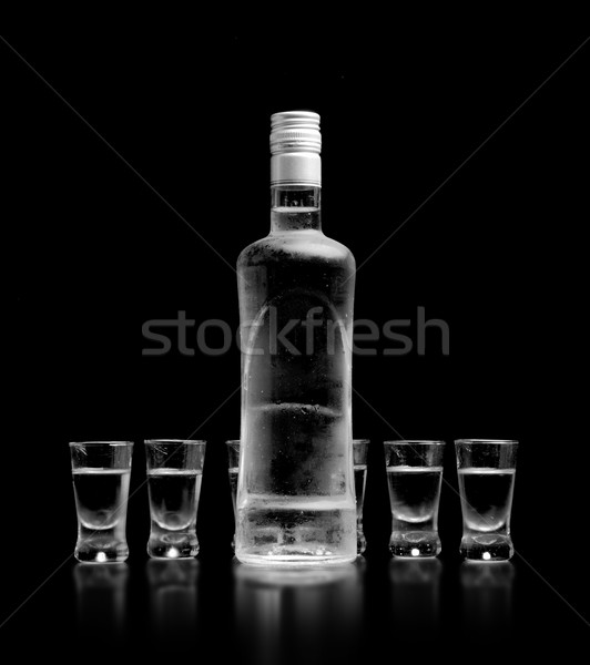 Bouteille verres vodka permanent isolé noir Photo stock © dla4