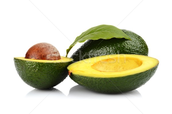 Studio shot of avocado with leaf and pit core isolated Stock photo © dla4