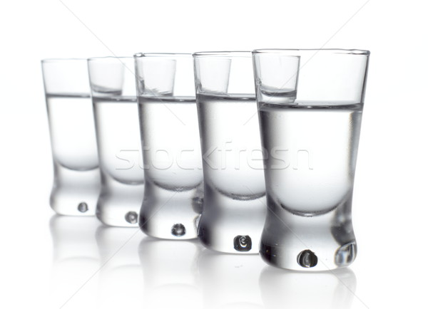 Cinco gafas vodka aislado blanco Foto stock © dla4