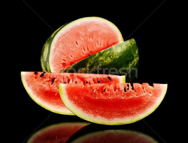 Studio shot whole and slice of watermelon isolated black Stock photo © dla4