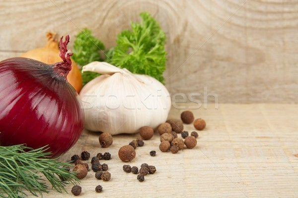 Onions,red onions,dill,parsley,pepper on wooden plank Stock photo © dla4