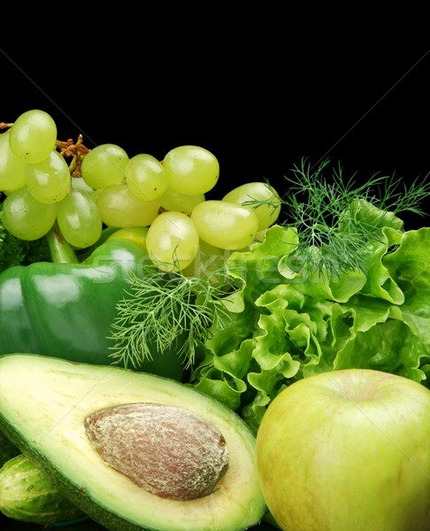 Group of green vegetables and fruits on black Stock photo © dla4