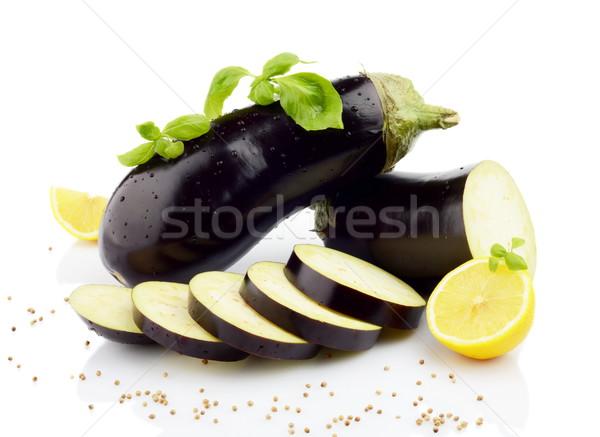 Sliced eggplants basil leaves,lemons,black pepper isolated white Stock photo © dla4