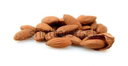 Csoport barna mandulák izolált fehér hámozott Stock fotó © dla4