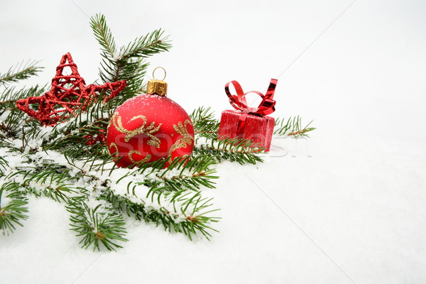 Red christmas gifts,baubles with red star and needles fir on sno Stock photo © dla4