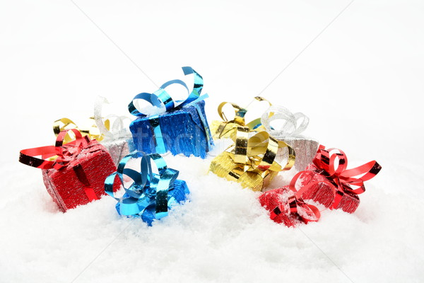 Stock photo: Three blue,red,golden,silver christmas gifts on snow