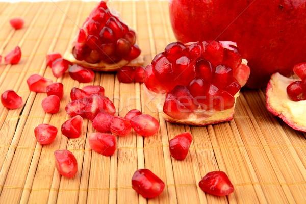 Studio shot open pomegranate on bright wooden mate Stock photo © dla4