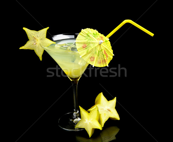 Cosmo margarita drink with carambola with ice on black Stock photo © dla4