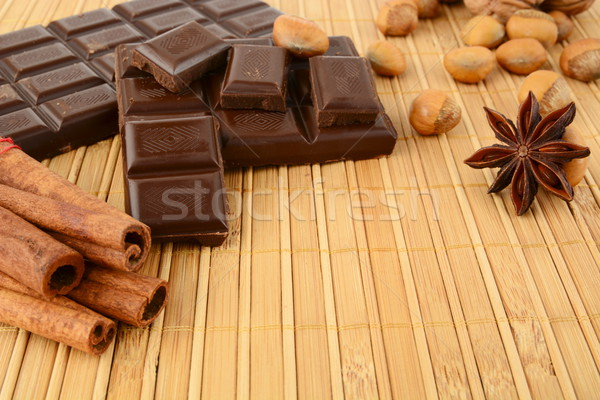 Romantic set of chocolate,anise and cinnamon on wooden mat Stock photo © dla4