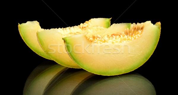 Melon galia slices, pieces isolated black in studio Stock photo © dla4