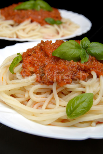 Pasta with ragu a'la bolognese on black background Stock photo © dla4