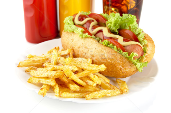 Hotdog with lettuce,tomatoes and cucumber on plate on white Stock photo © dla4