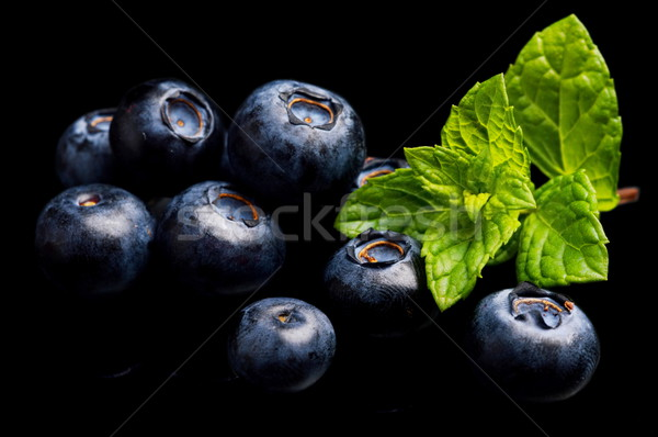 Stock photo: Macro closeup view blueberries leaves isolated black