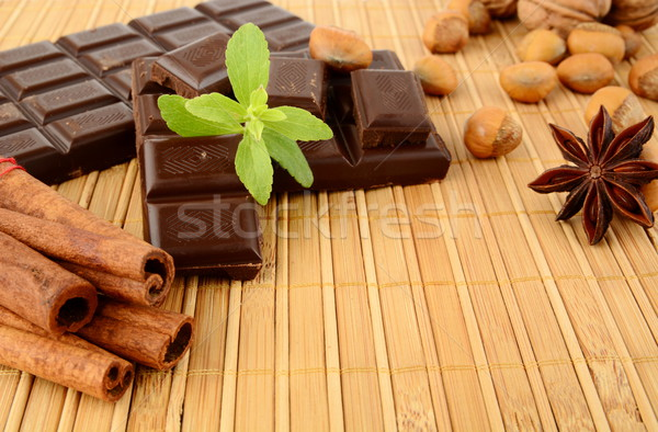 Set of chocolate,anise and cinnamon with sage on wooden mat Stock photo © dla4