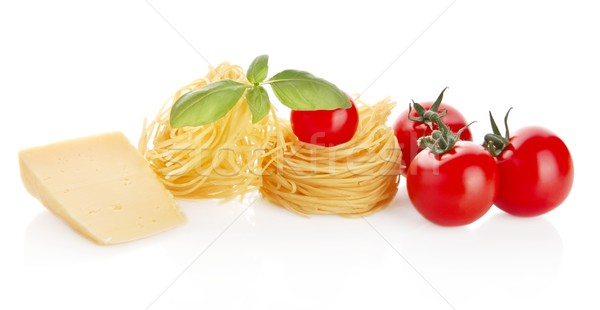 Studio shot of tomatoes,tagliatelle,basil and cheese on white  Stock photo © dla4