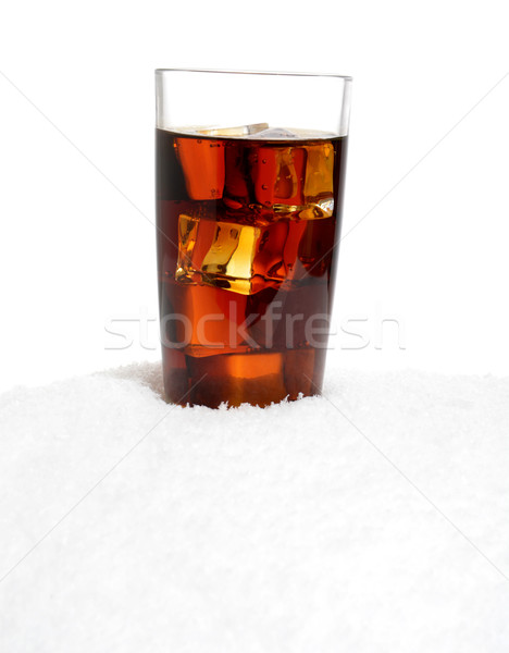 Glass of cola with ice cubes on snow on white Stock photo © dla4