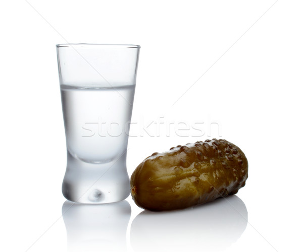 Glass of vodka with pickled cucumber isolated on white background Stock photo © dla4