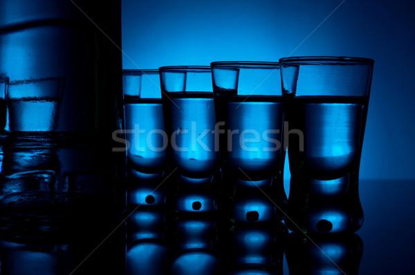 ボトル ウォッカ 多くの 眼鏡 青 バックライト ストックフォト © dla4