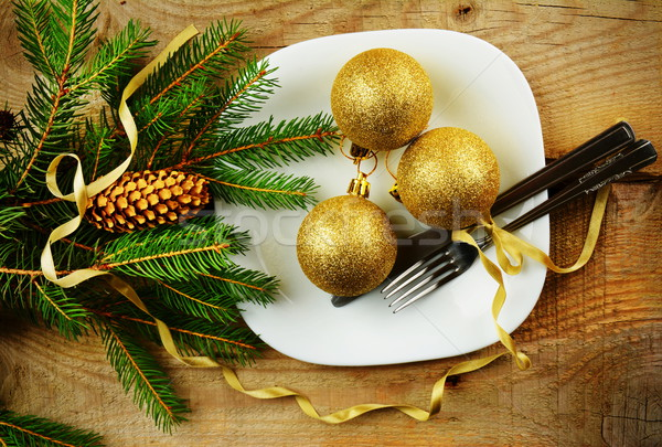 Christmas plate golden baubles pines wooden surface Stock photo © dla4