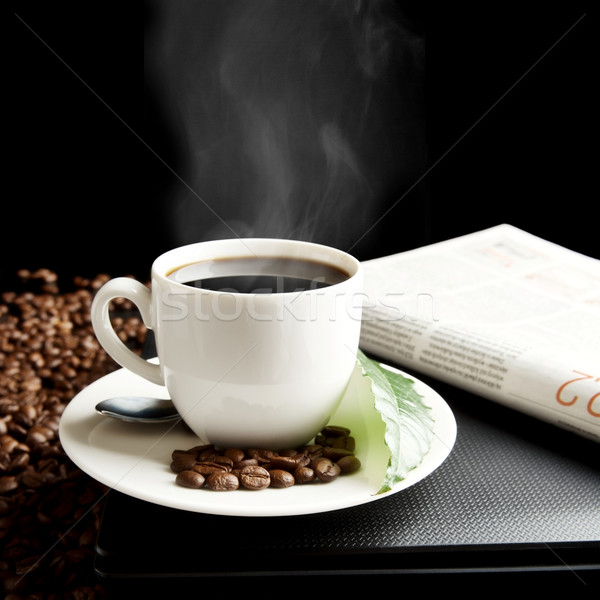 Cup of coffee with haze with laptop,newspaper,coffee leaf at breakfast Stock photo © dla4