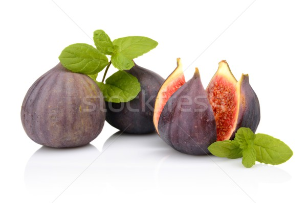 Three figs with mint,split like flower isolated on white backgro Stock photo © dla4