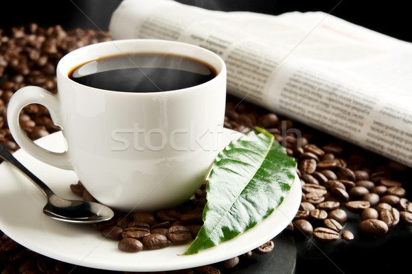 Cup of coffee with haze with newspaper,coffee leaf at breakfast Stock photo © dla4