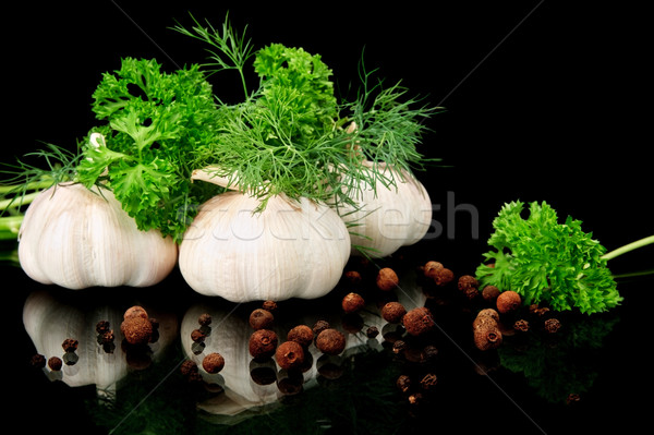 Dill leaves,garlic,pepper and allspice on black background Stock photo © dla4