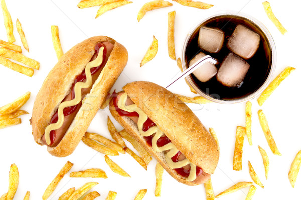 Hot dogs with french fries from above on white Stock photo © dla4