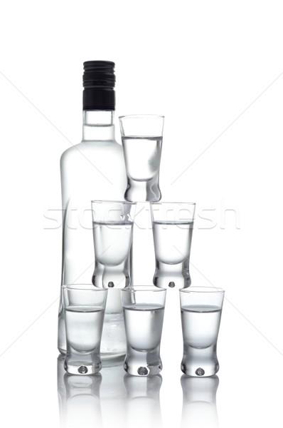 Butelki wiele okulary wódki odizolowany biały Zdjęcia stock © dla4