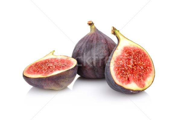 Three sliced figs isolated on white background  Stock photo © dla4