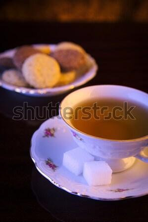 Afbeelding beker thee cookies zwarte porselein Stockfoto © dla4