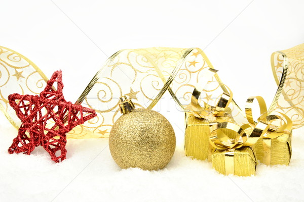 Golden christmas gifts,bauble ribbon on snow Stock photo © dla4