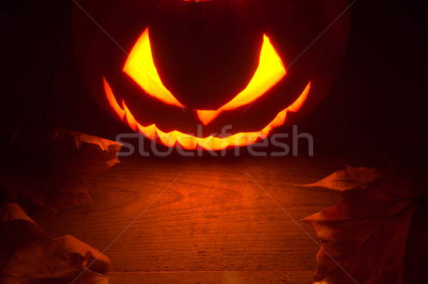 Scary halloween night with spooky evil face of jack o lantern at the top Stock photo © dla4