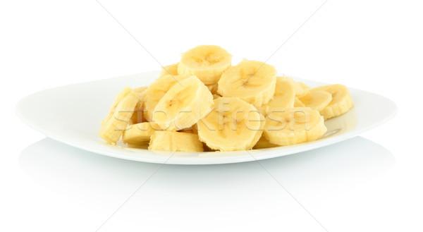 Macro shot of slices of banana on plate on white  Stock photo © dla4