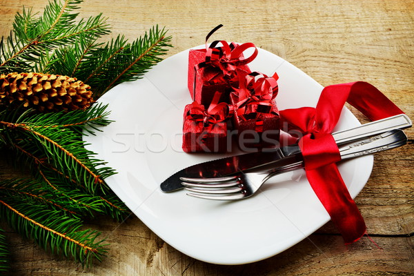 Christmas plate gifts with pines wooden surface Stock photo © dla4