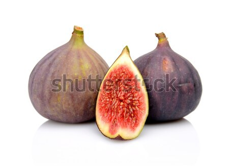 Three figs with quarter isolated on white background Stock photo © dla4