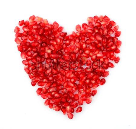 Red heart made from seeds of pomegranate,grenadine on white Stock photo © dla4
