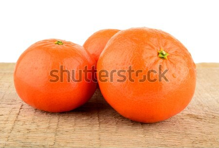 Studio shot mandarines,tangerines isolated on wooden table Stock photo © dla4