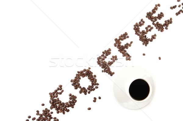 Coffee word arranged diagonally with coffee cup on white Stock photo © dla4