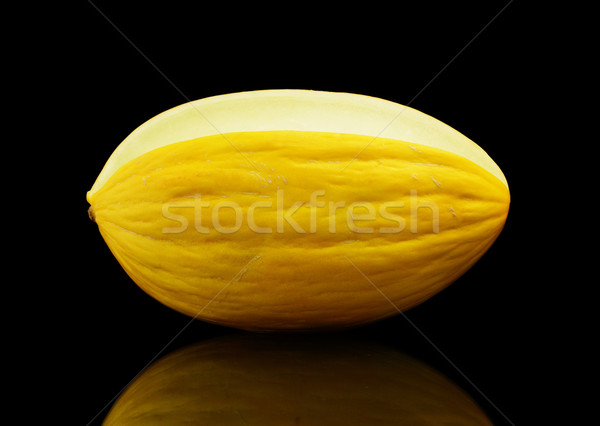 Whole yellow Canary melon isolated black in studio Stock photo © dla4