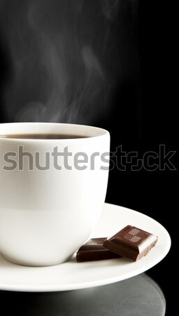 Cup of coffee with chocolate and saucer on black Stock photo © dla4