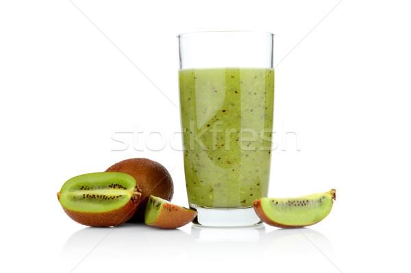 Group of sliced kiwi with juice studio shot white background Stock photo © dla4