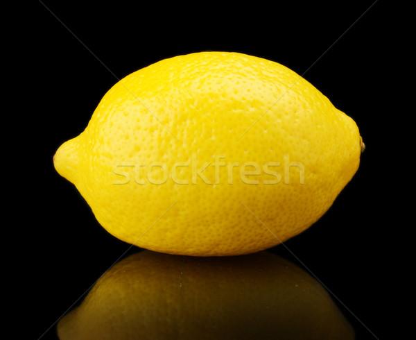 один лимона изолированный черный фон Сток-фото © dla4