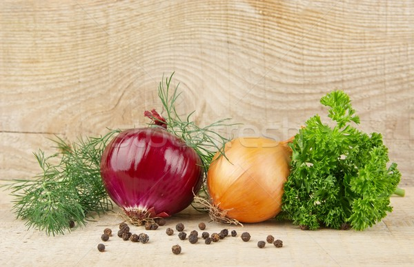 Onion,red onion,dill,parsley,pepper on wooden plank Stock photo © dla4
