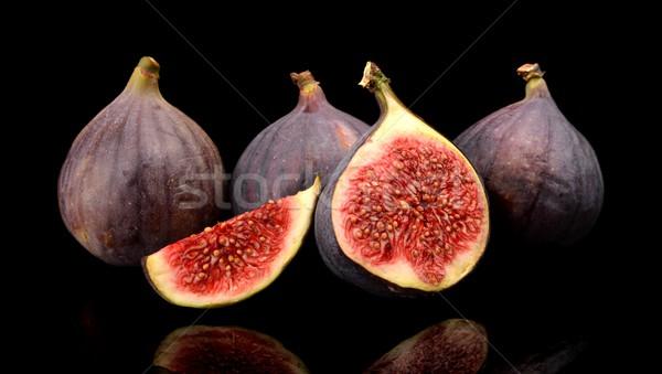 Group sliced figs isolated on black background  Stock photo © dla4