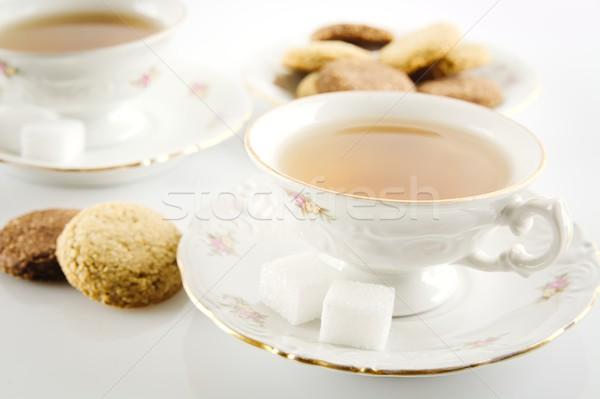 Tiro copo chá bolinhos branco Foto stock © dla4