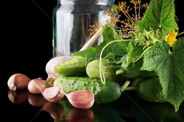 Coup jar noir concombres fleur Photo stock © dla4