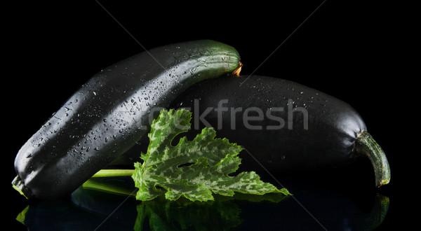 Mature zucchinis on black background Stock photo © dla4